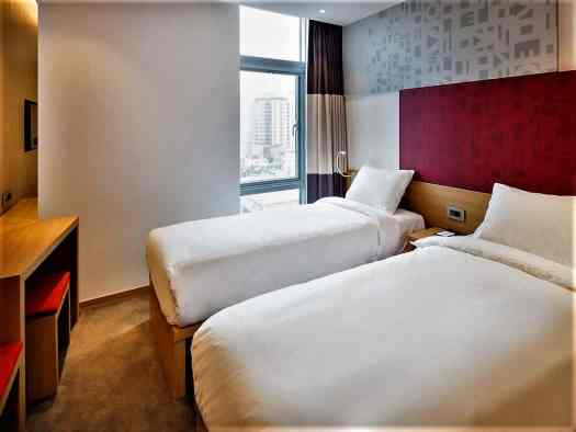 superior guest room with twin beds at Travelodge Dongdaemun in Seoul Korea