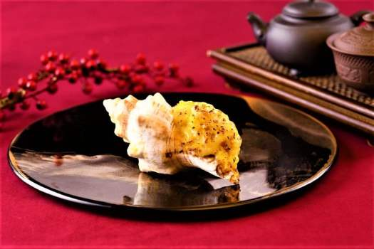 Baked stuff sea whelk with parmesan cheese at Ming Court Chinese restaurant in Kowloon