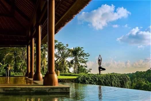 practising-yoga-overlooking-a-river-in-bali