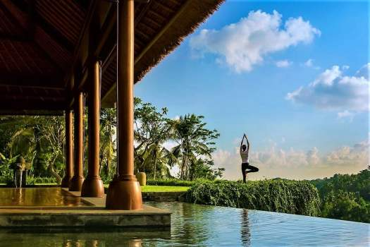 practising-yoga-overlooking-a-river-in-bali