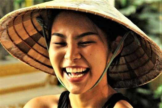 smiling-thai-woman-wearing-a-hat