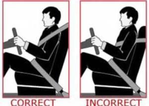 improper seat belt use under arm
