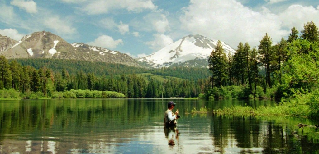 Scott Grant of Palo Alto, Calif., fly-fishes below the backdrop of volcanic Mount Lassen in 1995. This region is the focus of a bill in the state Legislature that aims to improve the health of California forests in order to improve water supply. Bob Galbraith, AP