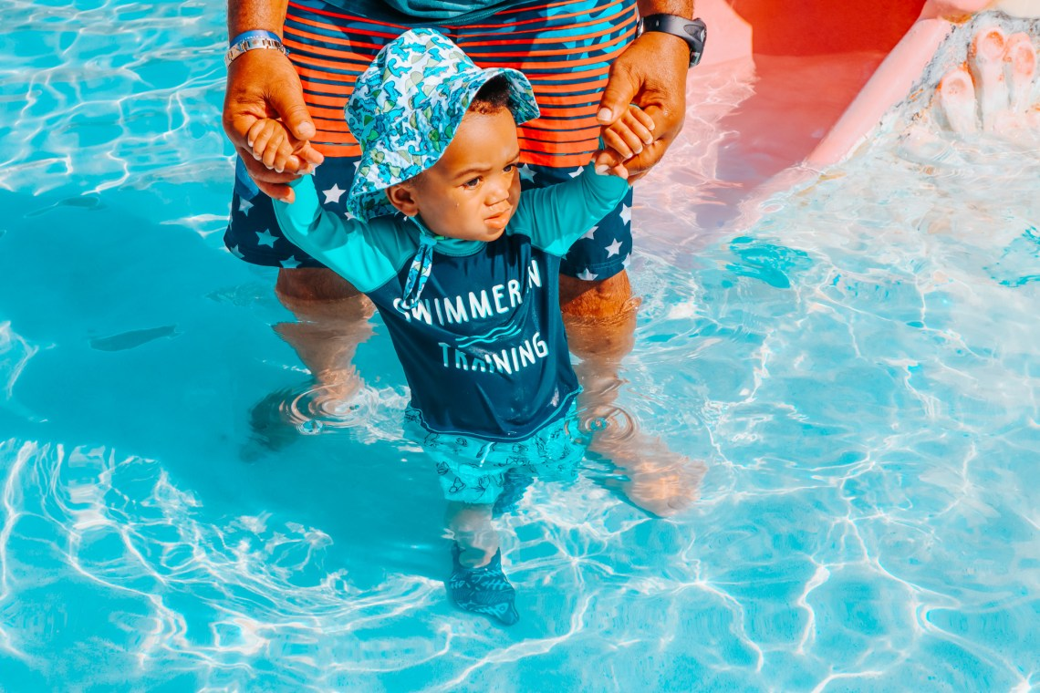 baby in pool which is a Kid Summer Activity