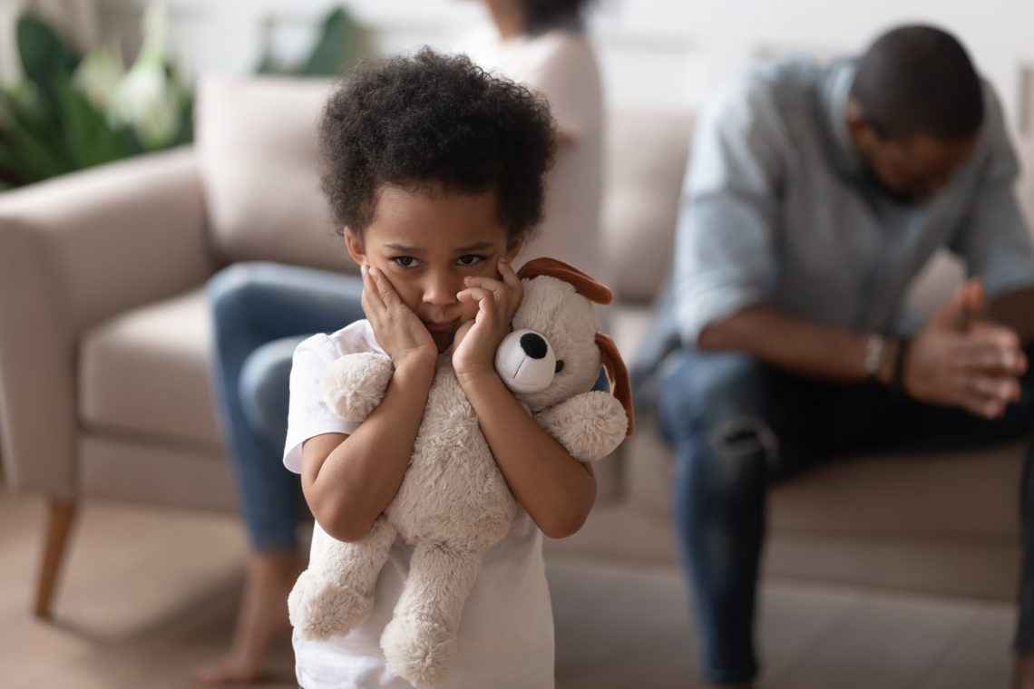 Focus on boy closed ears not to hear parents scandal