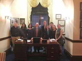 Standing behind VP Biden's former desk with Senator Coons.