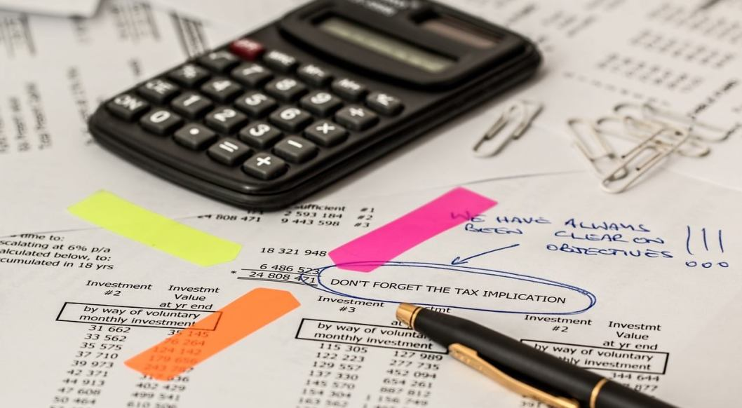 what are bookkeeping duties image of calculator and tax document