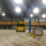 heavy duty forklift moving large crane beam/headers runway