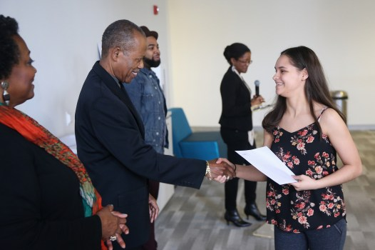 Stephanie Romero, right, shakes hands with program director Oscar Miller during the Acel Moore High School Journalism Workshop awards luncheon at the Philadelphia Media Network office in Center City on Saturday, April 7, 2018. The luncheon honored the 21 students who participated in this year's workshop. TIM TAI / Staff Photographer