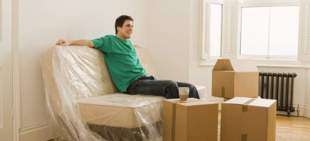 a man sitting on a couch after movers Raritan NJ have left
