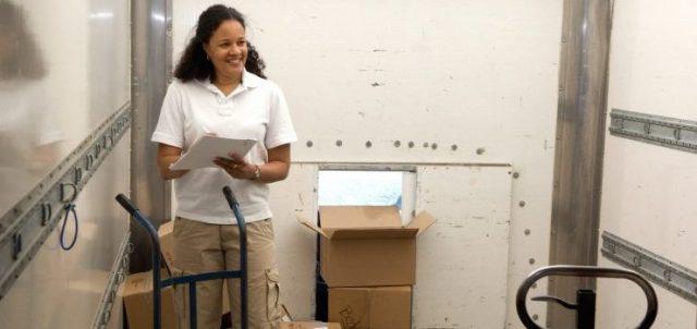 A woman unloading a truck