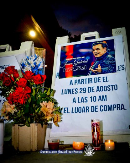 Fans have placed flowers and candles for the Iconic Mexican Singer Juan Gabriel gather outside the Don Haskins center. Juan Gabriel was set to Perform tonight at the Haskins center to a Sold out crowd.