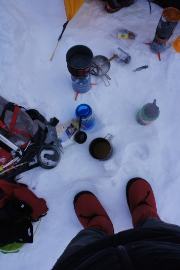 Melting snow and boiling water to keep warm.