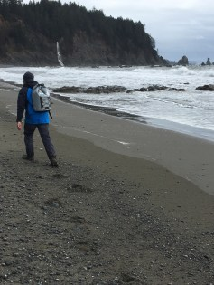 Glad to be on the beach with a backpack full of sandwiches and beer after a rough night in the rain forest. Photo: Colin Kimball.