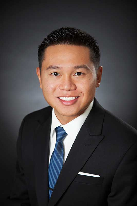 Corporate Headshot On Dark Background