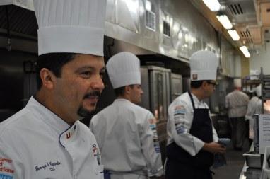 Team chefs George Castaneda, Matt Seasock and Joseph Albertelli preparing for service