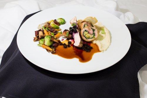 Chef Rubin's winning dish: smoked maple-scented breast of pheasant, cooked sous vide, and roasted pheasant leg roulade; medley of chestnuts, wild mushrooms, Brussels sprouts, micro carrots, pearl onions and lardons; celeriac-potato puree; huckleberry agrodolce; sauce Périgueux; and micro celery.