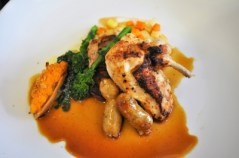 Chicken Sauté with Pan Sauce: broccoli rabe and creamed rabe greens; forcemeat barquette; root vegetable dice; and dried applie-juniper chicken sausage