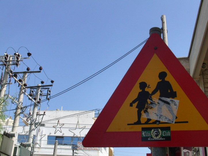 Road Sign indicating a pedestrian crossing near a school in Greece
