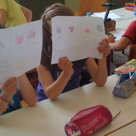 Learners in a Greek primary school showing off their work