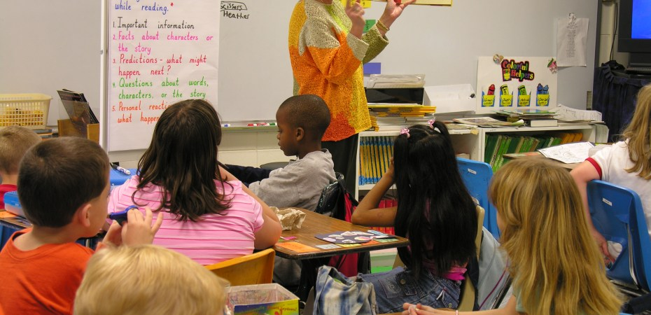 Teacher reading alound to group of first-graders