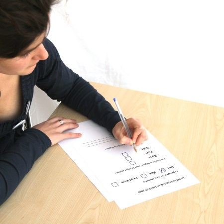 Young woman filling out a form
