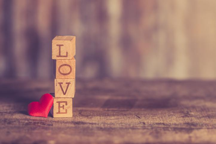 Stalk of wooden blocks, spelling love