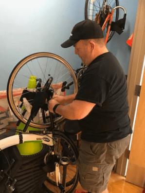 Dan working on the bike