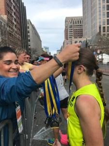 Stephanie Zundel getting a medal at the Boston Marathon