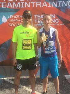 Guide Olaf (on the left) Athlete Michael( on the left) at the finish line of the Rock and Roll Marathon