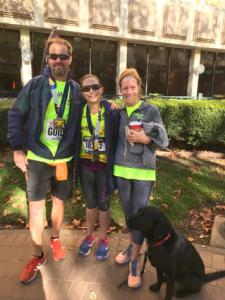 From left to right Guide Ed Sieffert, Athlete Stephanie Zundel, Guide Dog Marley, Guide Amy Harris