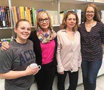 ACHS Founding President Dorene Petersen with three students