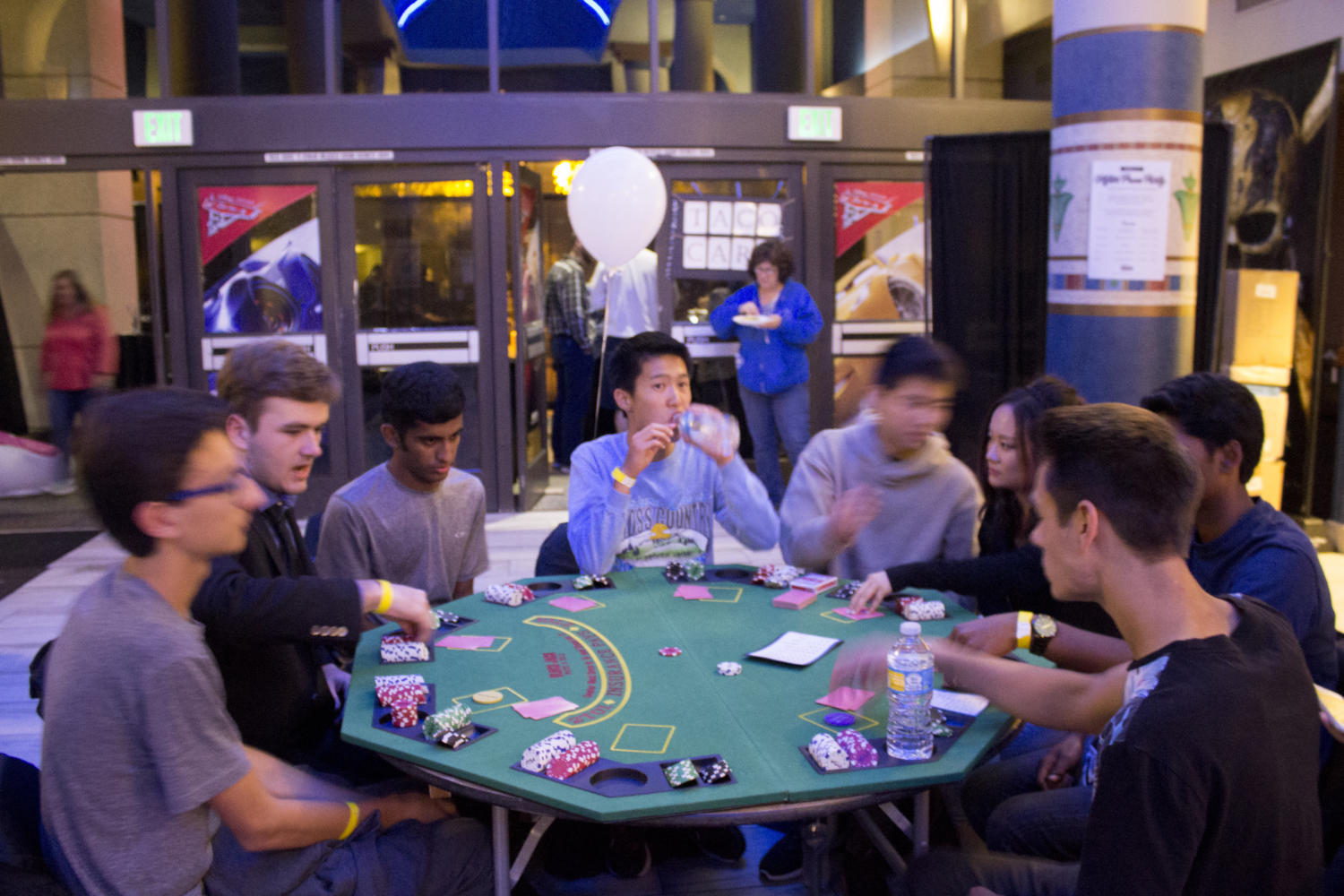 Seniors playing a game of poker at After Prom.