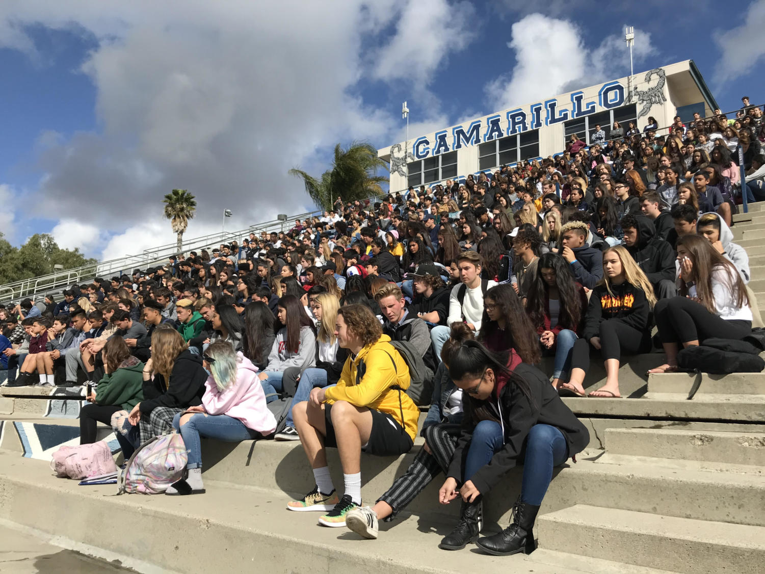 Students attend the walkout on March 24 by gathering in the stadium to honor the victims of the Parkland shooting.