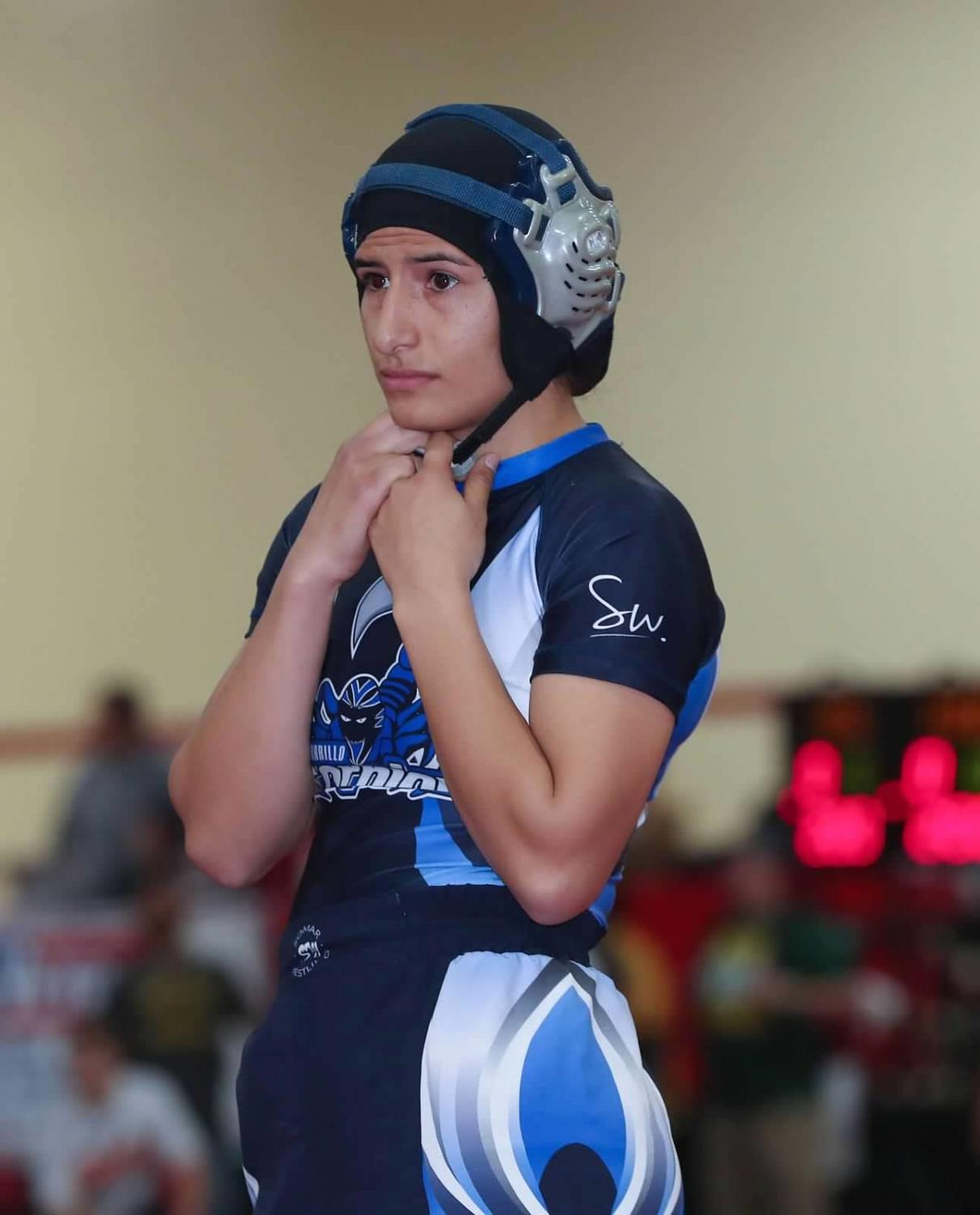Yasmine Gonzalez looks into the ring before her match while wearing her wrestling gear. Photo by Gaby Jose