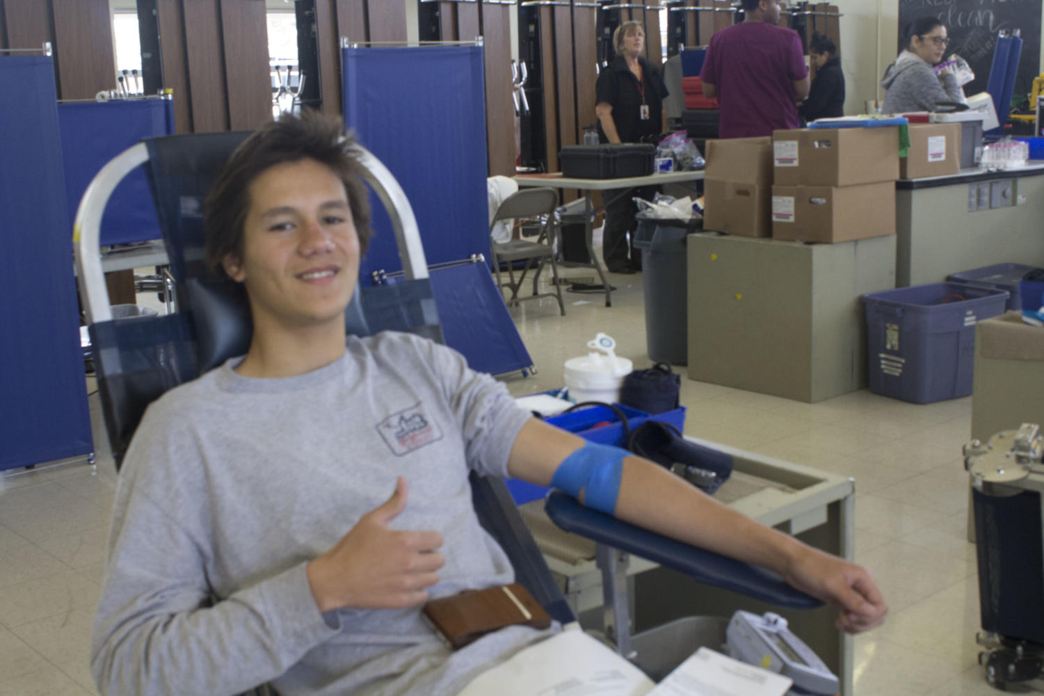 Jacob Curren donating blood at Cam High's bi-annual blood drive. Photo by Shaeley Hicks.