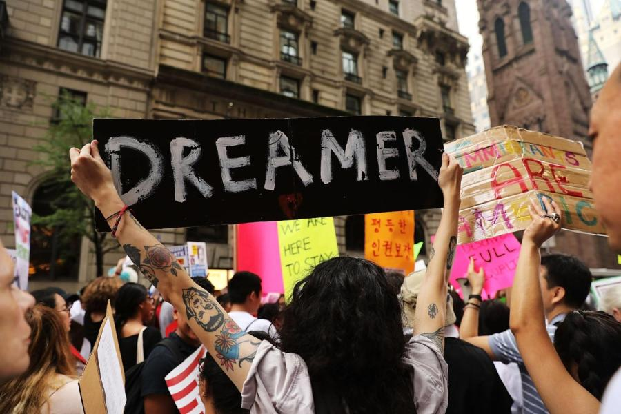 provided+by%3A+https%3A%2F%2Fwww.popsugar.com%0A%0A+A+protester+holding+up+sign+that+says+%22DREAMER.%22%0A