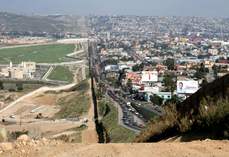 A+small+fence+separates+densely+populated+Tijuana%2C+Mexico+%28right%29+from+the+United+States+in+the+Border+Patrol%27s+San+Diego+Sector.