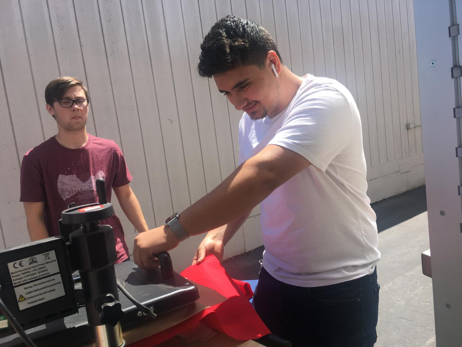 Jonny Samaan helping Justin Terryberry with the T-Shirt Press.