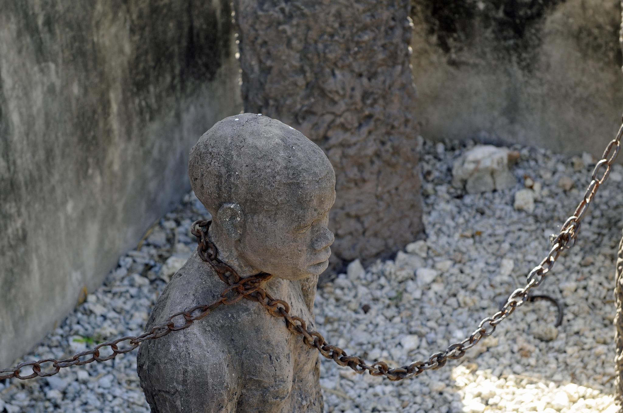 stone statue of a slave