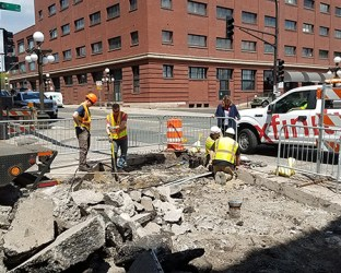 Utility work beginning at the corner of 6th & Wall