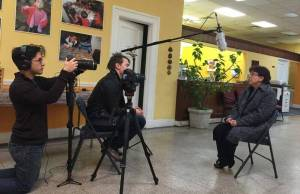 A team from Victory Church films Director of Social Services Margarita Contreras at ACLAMO's Norristown offices.