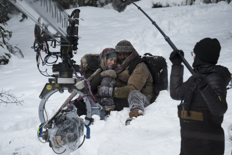 Kate Winslet and Idris Elba filming, with Boom Operator Jon Lavender in shot - PHOTO Supplied