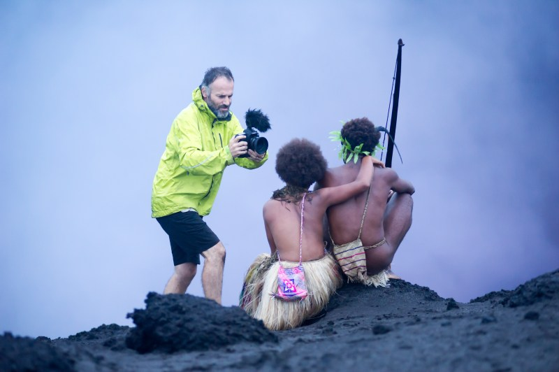Cinematographer Bentley Dean films Mungau Dain and Marie Wawa at a volcanic crater for the film 'Tanna' - PHOTO Philippe Penel