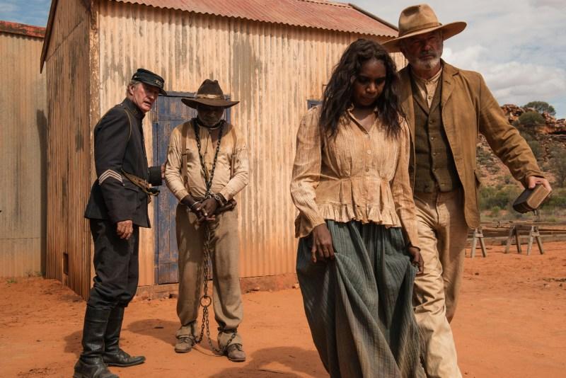 Sergeant Fletcher (Bryan Brown), Sam Kelly (Hamilton Morris), Lizzie (Natassia Gorey Furber) and Fred Smith (Sam Neill) in a scene from 'Sweet Country' - DIR Warwick Thornton, DOP Dylan