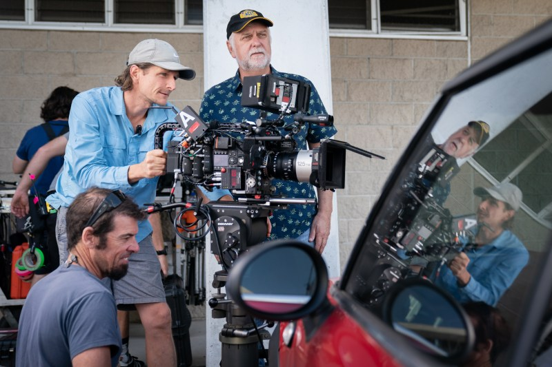 Clockwise, Key grip Paul Micallef (kneeling) and first assistant camera Pim Kulk behind the camera with cinematographer Henry Pierce ACS .jpg