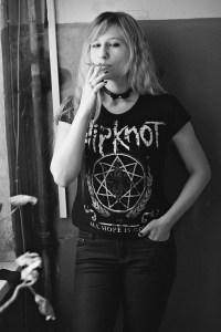 Woman smoking in band t-shirt
