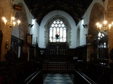 Crantock: the chancel which has several broad steps up to the altar