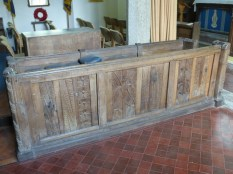 Poundstock: old bench-ends creatively incorporated into the choir stalls