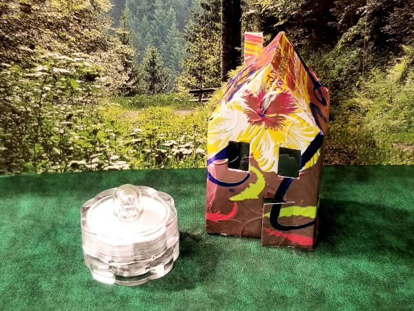 Aluminum can tiny house luminary with light